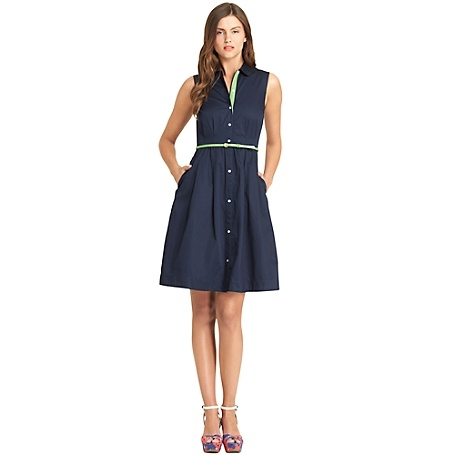 Tommy Hilfiger women's dress. Flattering and a breeze to wear–our shirtdress with a splash of interior color does the work for you, leaving more time to field all those compliments.• Classic fit, approximately 41 ½ inches from shoulder to hem.• 100% cotton.• Pleated, removable contrast color belt, custom buttons.• Machine washable.• Imported.