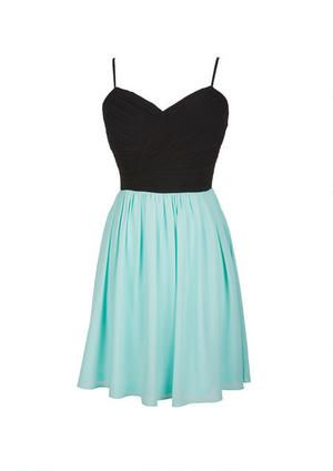 Join the glamazon in this party pefect dress. Fully lined with a pleated bodice (with back zipper) and kick-out skirt. The spaghetti straps are adjustable too!