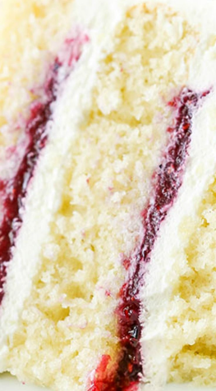 Berry Mascarpone Layer Cake ~ Layers of fluffy vanilla cake, fresh berry filling and mascarpone whipped cream frosting... It's light, fruity and perfect for spring!