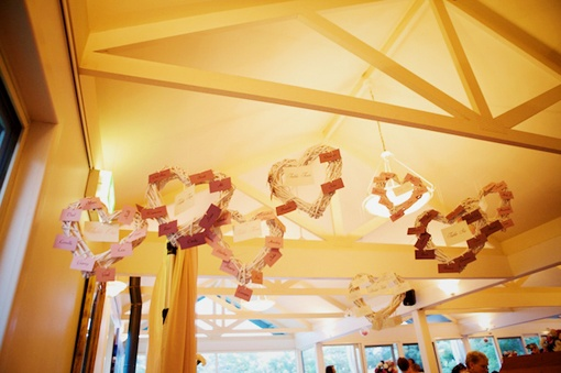 Our white hearts were attached with guests names for their tables.  www.capeofove.com