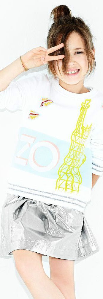 KENZO KIDS Girls White Eifel Tower Statue of Liberty Sweatshirt Metallic Silver Skirt  for Spring Summer 2018. Love this cute mini me look Inspired by the Kenzo Women's Collection. Perfect Streetwear Look with a fun print t-shirt and super cute metallic skirt for a little princess. Pretty Summer Look for a stylish kid, tween and teen girls.    #kenzo #girlsdresses #kidsfashion #fashionkids #childrensclothing #girlsclothes #girlsclothing #girlsfashion