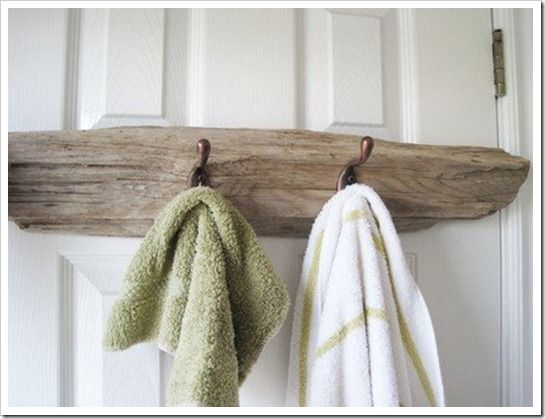 Another natural and beachy DIY idea is to use a piece of drift wood and attach a few hooks.