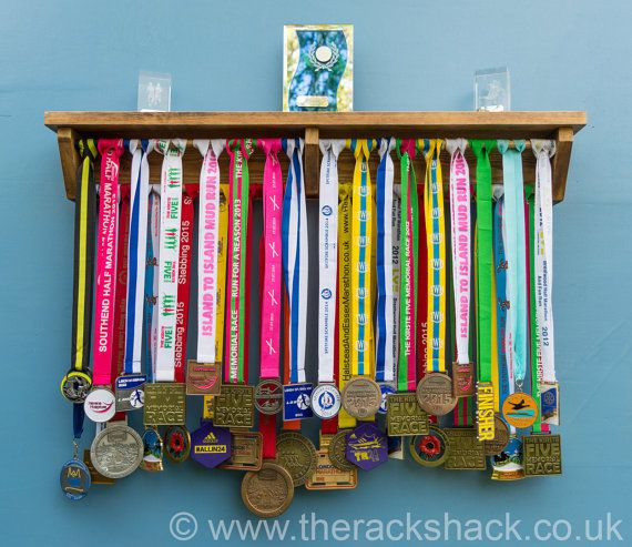 Wooden Medal Hanger Display Shelf Trophies 4 sizes running gymnastics marathon  Display your medals and trophies with pride. Solid wood Handmade Easy to install Would make a great gift for that sporty friend  Medal Hanger Display Rack with a shelf for trophies. Made from solid wood this medal rack will really show off you running/gymnastics/cycling/sporting achievements. Also an ideal gift for a runner friend.  Medals are very easy to hang on the medal display. You can place trophies, race…