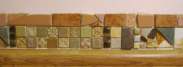 Closeup of tile border. Some of the tiles are salvaged, some made by me, and a few were purchased.