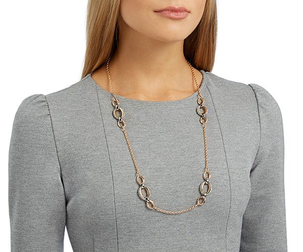 A bold, organic design. This long strandage necklace offers an on-trend look with its gourmette chain silhouette and mixed metal plating. Shiny... Shop now