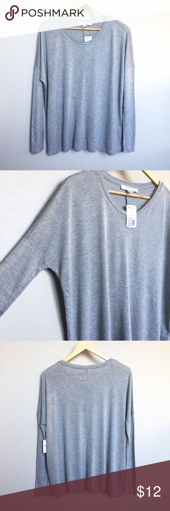 Grey Babydoll Shirt Brand new with tags! I just purchased this top at Forever 21 but I didn't like how it looked on me after trying it on at home 😣 My loss is your gain! It's VERY sort and thin material. The arms are tighter fitting and the torso area is flowy. It fits like a batwing-type shirt. No flaws. Measurements available upon request! Size small but fits like a medium. Forever 21 Tops Tees - Long Sleeve