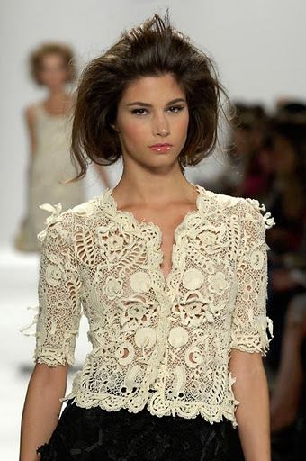 Oscar De La Renta. Very elaborate lace yet not overpowering or heavy.