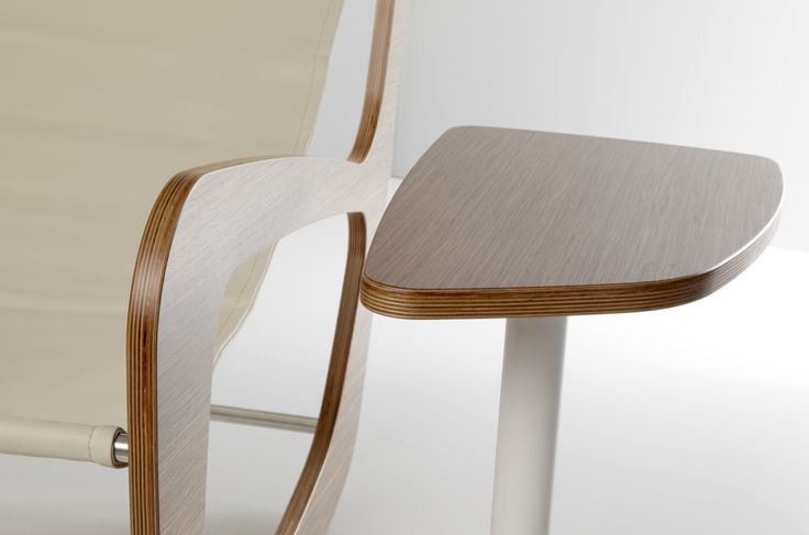 Infinity Rocking armchair and side table, plywood, leather and steel details