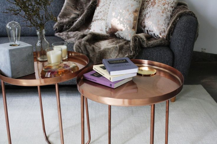How to style your coffee table | Moody Luxe - The coffee table should be made up of a collection of items that evoke different emotions and create talking points for your guests. When using a coffee table with a unique finish like this copper one, it is great to use a variety of materials such as glass and concrete to contrast. For more detailed instructions on how to style your coffee table, check out our blog.