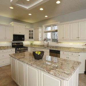 fresh kitchen design with white cabinet and Sienna Bordeaux Granite also recessed lighting