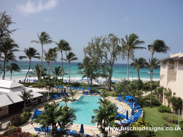 Turtle Beach Resort in Barbados.  The beautiful pool sits just on the edge of the stunning aquamarine private beach.  By www.fuschiadesigns.co.uk.