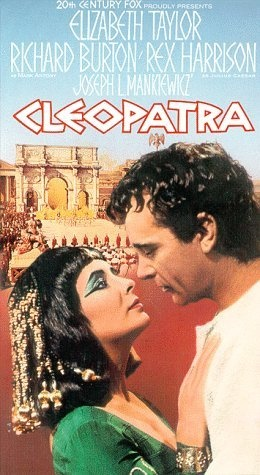 Elizabeth Taylor and Richard Burton in Cleopatra (1963).  There's just one big problem: the triumphal arch depicted on the poster and in the movie didn't exist at the time Cleopatra came to Rome!