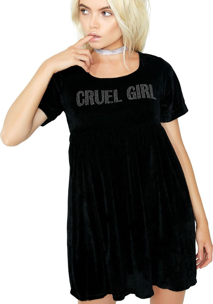 """O Mighty Cruel Girl Velvet Babydoll Dress you're not so innocent. This black velvet dress has a flowy skirt with silver bedazzled """"CRUEL GIRL"""" text across the chest, and a hidden zipper closure on the back."""