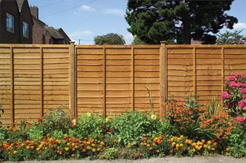 BUY NOW ON D.W. NYE BUILDERS MERCHANT   A Grange favourite, this well-made, traditional garden fencing lap panel is constructed with a double framed overlap panel as standard. A sturdy wooden garden fence panel that is 42mm thick. The featured double waney edge slats undergo a golden brown colour treatment process to help protect this Grange golden brown timber fencing panel from wood rot and decay.