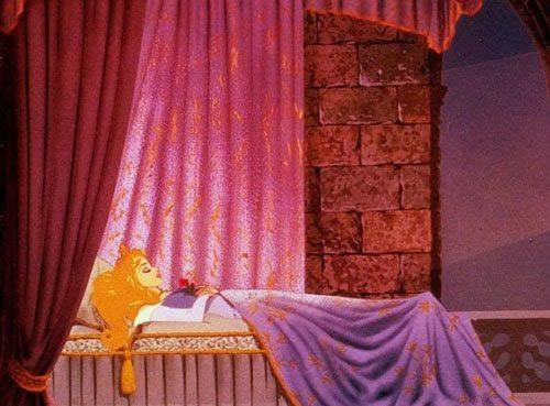 Aurora asleep and waiting for her prince in Sleeping Beauty 1959 animatedfilmreviews.blogspot.com