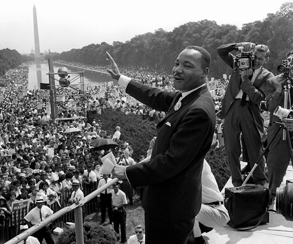 MLK Assassination Death Anniversary: Museum to Honor Civil Rights Leader |U.S. civil rights leader Martin Luther King, Jr., waves to supporters from the steps of the Lincoln Memorial 28 August, 1963, on The Mall in Washington, D.C., during the 'March on Washington' where King delivered his famous 'I Have a Dream' speech, which is credited with mobilizing supporters of desegregation and prompted the 1964 Civil Rights Act. (AFP/Getty Images)