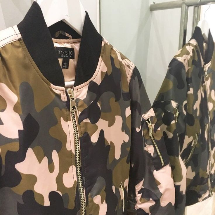 Take the utilitarian look to the next level with the camo printed bomber jacket. Complete with authentic MA1 details, ribbed trims and contrasting pink details. #Topshop