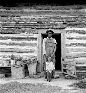 Young sharecropper and his first child, Hillside Farm, Person County, North Carolina, 1939 by Dorothea Lange, 1895-1965, American photographer