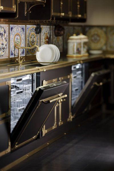 Stunning butler's pantry by Officine Gallo (Italy) featuring twin dishwashers, a brass faucet and countertop, and a backsplash of tile medallions.