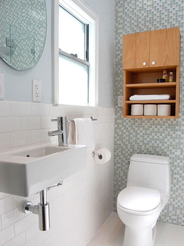 This sink would work in our very narrow guest bath. Two people can't fit into it at the same time! I like the sea glass tile going up the wall behind the toilet, but one has to consider resale value. Awesome to me might equal tacky to others!