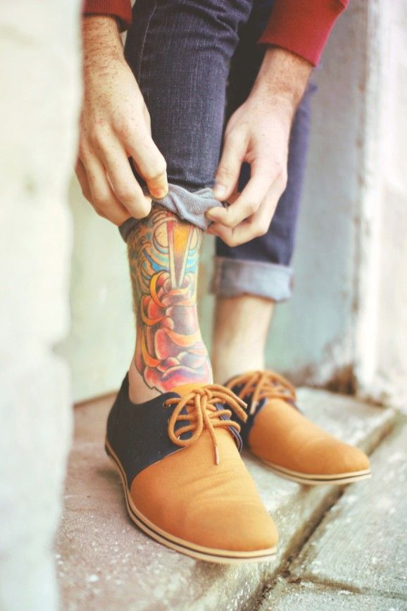 Colored tattoo on the leg