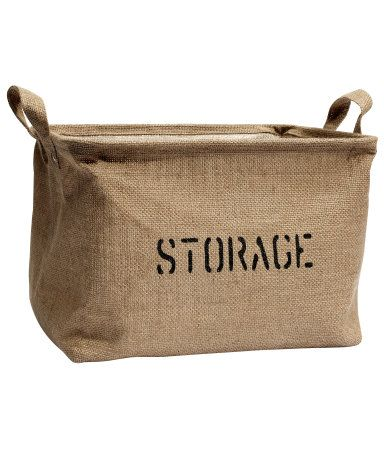 Jute storage basket £7.99 DESCRIPTION Storage basket in a jute weave with a print on the front and plastic lining. A metal rim at the top provides stability. Two handles. Size 24x25x32 cm. DETAILS 100% jute. Art.No. 61-7586