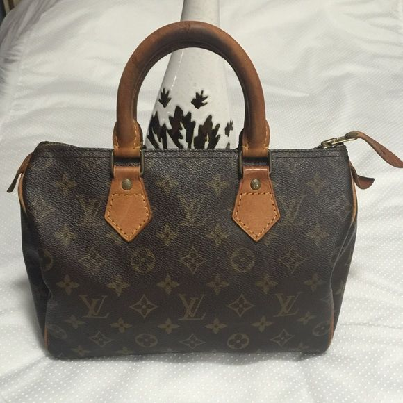 Authentic Louis Vuitton Speedy 25 This LV speedy is in very good used condition. It does have flaws but nothing major. Darker patina on the handles, some rubbing & scratches on edges and piping. Clean interior with some wear on the pocket from normal use. The leather zipper pull has a light crack not noticeable. No accessories included Louis Vuitton Bags Satchels