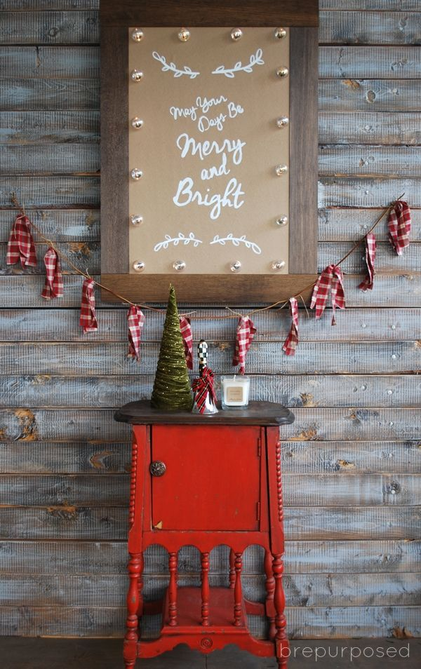 Christmas Marquee Sign DIY using clear clear ornaments and battery powered Christmas lights.