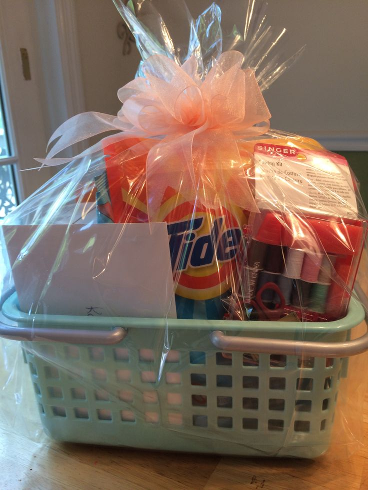 Going off to college gift.  Just a few items and a cute, colorful container.  Laundry items included in this basket are: Tide laundry detergent pods (perfect size for college students), dryer sheets, stain remover, pop up hamper, delicates bag, disinfectant wipes, small sewing kit.  You could also add a lint brush and air fresheners.