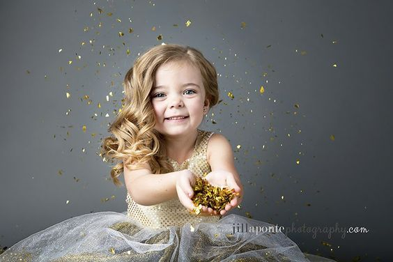 A gray background is perfect for a glitter photo session for kids!