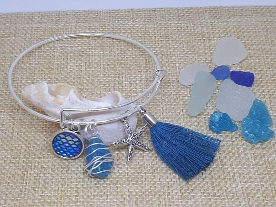 Check out this item in my Etsy shop https://www.etsy.com/ie/listing/544828078/turquoise-blue-tassel-silver-bangle