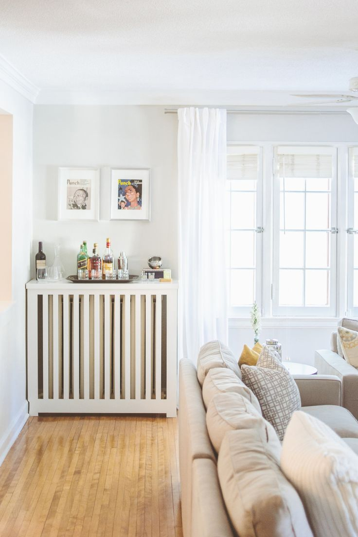 Hide an unsightly radiator: http://www.stylemepretty.com/living/2014/01/22/20-ways-to-decorate-your-walls/