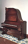 NMM 1212.  Upright piano ('giraffe') by Schimmel and Nelson, Faribault, Minnesota, ca. 1889