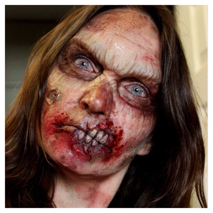 Love this zombie look, it looks so realistic. And the prosthetic teeth looks brilliant, I am going to recreate the prosthetic teeth look on my zombie using latex and false nails to make my own.