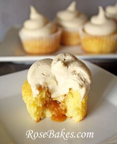 Caramel Filled Yellow Cupcakes with Whipped Caramel Frosting! Click over for the recipe and lots of pics!