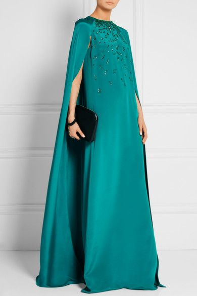 OSCAR DE LA RENTA Cape-effect embellished silk-satin gown $4,490 EXCLUSIVE AT NET-A-PORTER.COM. Oscar de la Renta's fluid teal silk-satin gown is hand-embroidered with tonal crystals and beads in an elegant dégradé effect - an intricate process that takes 45 hours to complete. It's designed with a cape-back that sweeps over the shoulders and falls dramatically to the floor. Keep accessories minimal. Shown here with: The Row Clutch, Aquazzura Sandals, Kenneth Jay Lane Ring.