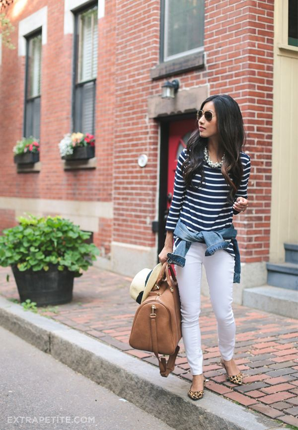 navy blue and white striped shirt, jean jacket tied around the waist, and white jeans