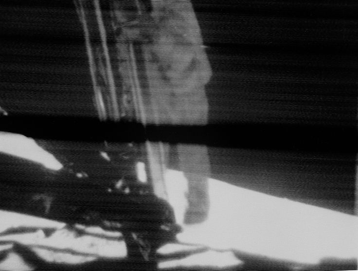Apollo 11 commander Neil Armstrong descends the ladder on the lunar module Eagle on July 20, 1969 in this still image of a live TV broadcast during the first manned moon landing.