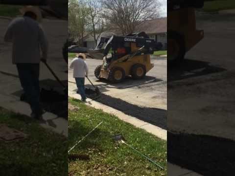Installing Asphalt patch to city roads. Asphalt Patch Repair
