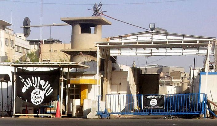 Photo: A black flag used by the the jihadist Islamic State of Iraq and Syria (ISIS), which now goes by the name the Islamic State (IS) hangs at the entrance of Nineveh governorate in Mosul city, northern Iraq, 25 July 2014. EPA/MOHAMMED AL-MOSULI