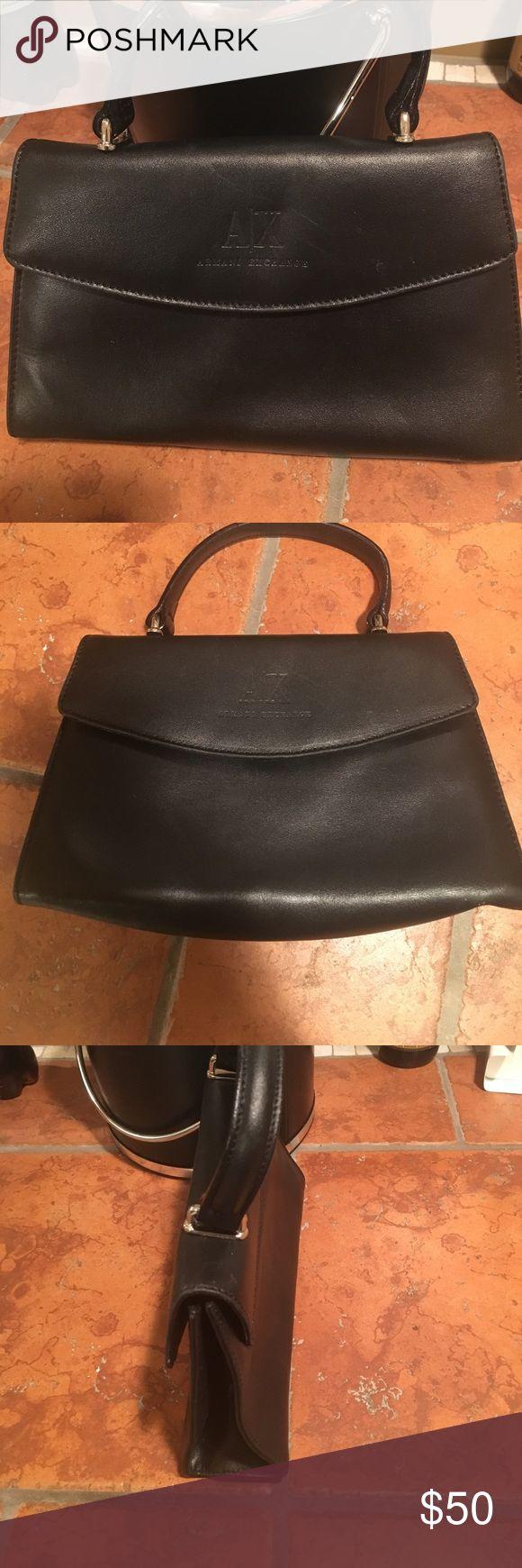 Armani Exchange purse. Small black classic Armani Exchange purse.  Like brand new. A/X Armani Exchange Bags Mini Bags