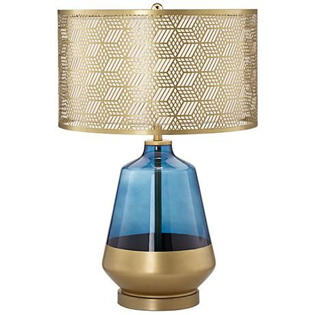 This striking cobalt blue and gold contemporary table lamp features a blue glass base and a cut-out metal drum shade.