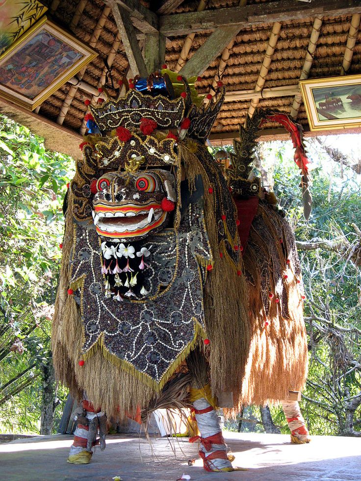 Barong is a lion-like creature and character in the mythology of Bali, Indonesia. He is the king of the spirits, leader of the hosts of good, and enemy of Rangda, the demon queen and mother of all spirit guarders in the mythological traditions of Bali. The battle between Barong and Rangda is featured in Barong dance to represent the eternal battle between good and evil. This elaborate Barong is kept in a pavilion in the inner courtyard of Pura Taman Ayun, the royal temple of the Mengwi…