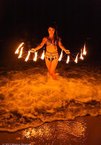 Fire Dance in the ocean by KAORU  www.rainbowdancearts.com
