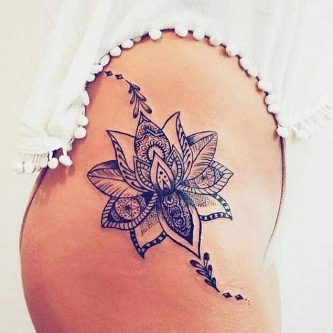 Tatouage de Femme : Tatouage Fleur de lotus Noir et gris sur Cuisse !