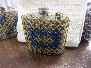 Protect your drinks!   Chain mail covered flask.  Nice!   Bcchains Chain Mail and more on facebook.