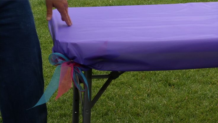 Don't let the wind spoil your picnic party! Learn a trick for covering your tables with plastic or fabric tablecloths and making them stay secure (and cute).