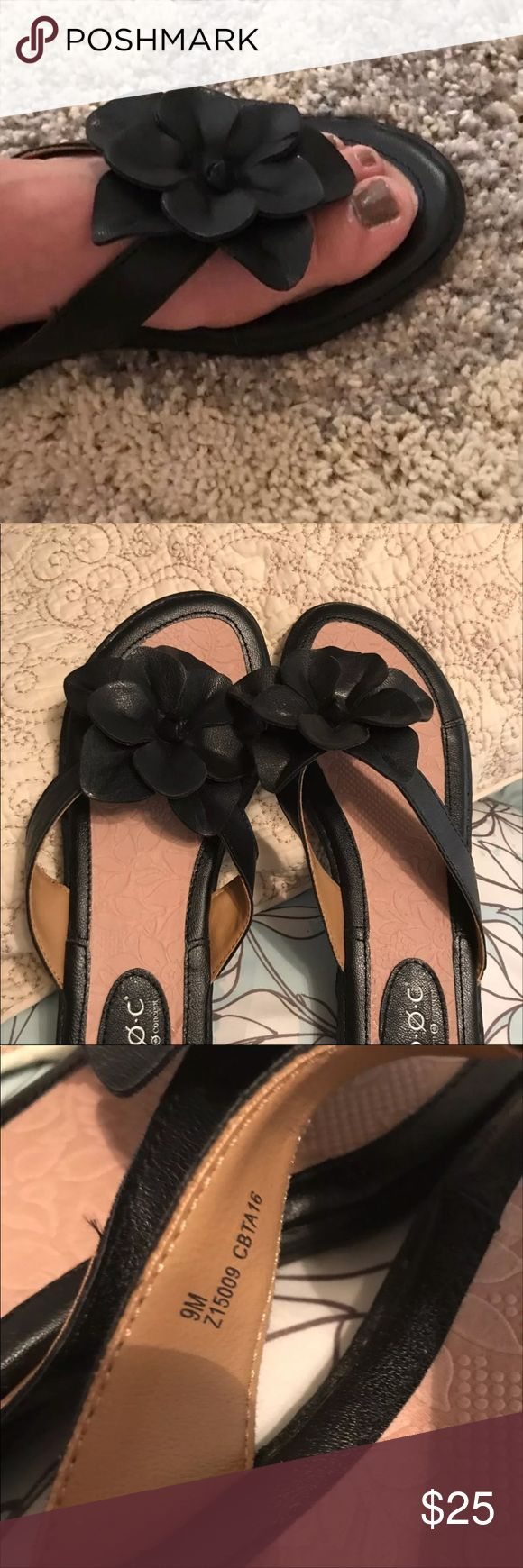 Women's Flip Flops Size 9 These were purchased from famous brand shoes. They are genuine leather with black floral design and brown soles. Brand new and never worn! b.o.c. Shoes Sandals