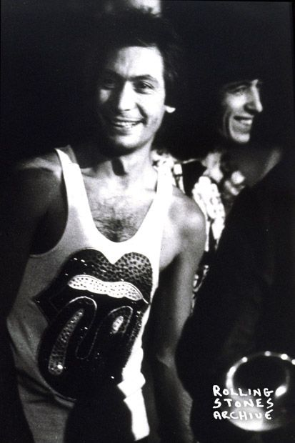 Charlie Watts & Bill Wyman, Europe 1973. The only photo I've ever seen of Charlie smiling.