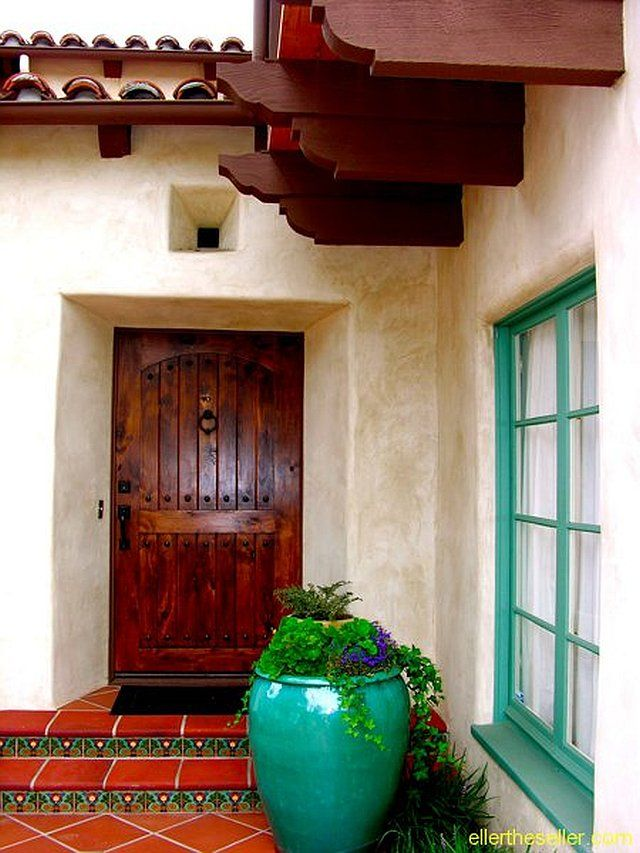 Spanish revival colorful entry spanish colonial for Spanish colonial exterior paint colors